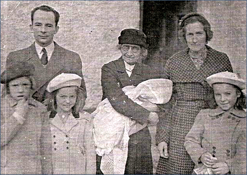 Nurse Moffett with the Carroll family c. 1951